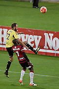 Andrew Durante (Top) of the Phoenix lands on West Sydney's Romeo Castelen during the A-League - Wellington Phoenix v Western Sydney football match at Westpac Stadium in Wellington on Sunday the 10 April 2016. Copyright Photo by Marty Melville / www.Photosport.nz