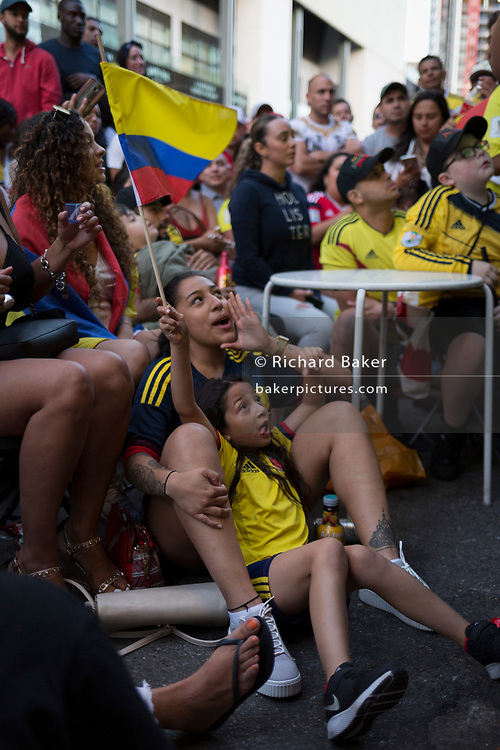 Colombian football fans living in London watch their team's eventual 4-3 loss (after penalties) with England in the knock-out stage of the World Cup at Elephant and Castle, on 3rd July 2018, in London, England. 15,000 Colombians have established a thriving community in London, many in the south London borough of Southwark, as well as other south American expatriates. (Photo by Richard Baker / In Pictures via Getty Images)