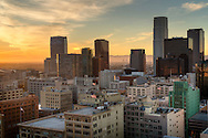 Dramatic Cityscape of los Angeles skyline at sunset. Camera view looking south west from top of SB tower at corner of 6th and Spring