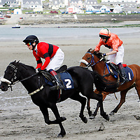 Danny Mullins and Maniac leads the first race home at the strand racing in Kilkee on Sunday.<br /><br /><br /><br />Photograph by Yvonne Vaughan.