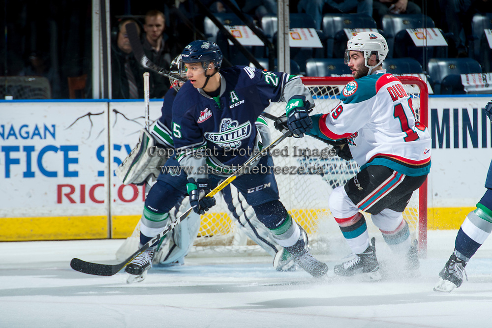 KELOWNA, CANADA - APRIL 25: Ethan Bear #25 of the Seattle Thunderbirds is checked by Dillon Dube #19 of the Kelowna Rockets during first period on April 25, 2017 at Prospera Place in Kelowna, British Columbia, Canada.  (Photo by Marissa Baecker/Shoot the Breeze)  *** Local Caption ***