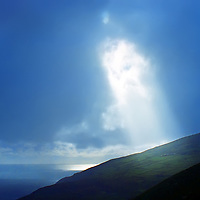Sunbeam and Stormy weather over Bolus Head Tower by Ballinskelligs County Kerry Iveragh Peninsula Ireland / bs029