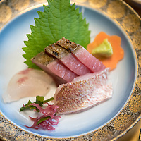 Sashimi at a local restaurant on Dogo, the largest island of the Oki Islands which is an archipelago in the Sea of Japan, Shimane Prefecture, Japan.