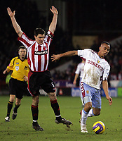 Photo: Paul Thomas.<br /> Sheffield United v Aston Villa. The Barclays Premiership. 11/12/2006.<br /> <br /> Gabriel Agbonlahor (R) of Villa gets past Chrin Morgan.
