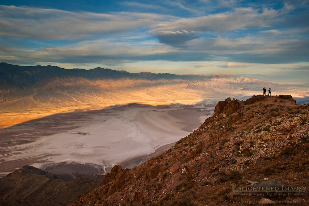 Tourists overlooking Panamint Mountains over Badwater Basin,  from Dantes View, Death Valley National Park, California