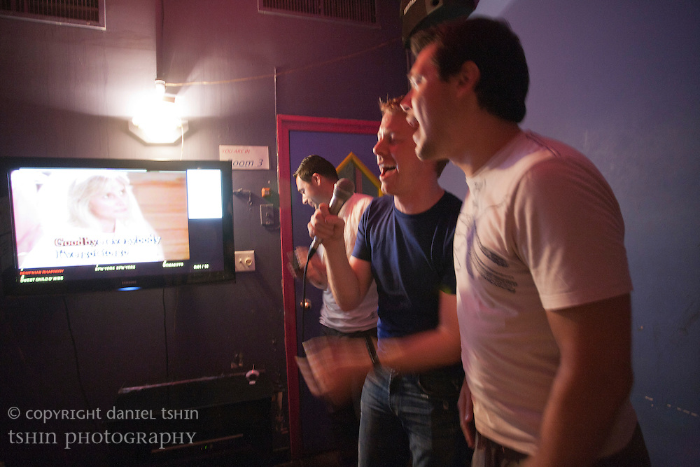 Having a karaoke blast with friends in a Karaoke dive in Alphabet City