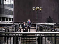 Two business men descending steps