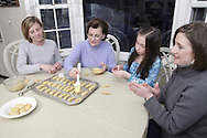 (from left) Joannie Bonanno, from Powell, Ohio; Evan Valassiades, from Kettering; Katie and Maria Kopan, from Sylvania, Ohio make Koulourakia (butter cookies) as they prepare for a traditional Greek Orthodox Easter, Monday, March 24, 2008.