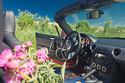 mazda mx-5 sportster red car in Kazimierz Dolny town and in red poppies in Poland
