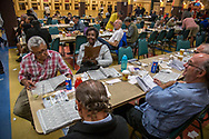 A group of people hangout by the betting windows' area of Santa Anita Park as the watch races on TV the day of the Kentucky derby celebrated on May 6, 2017. <br />