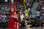 Team USA forward Swin Cash (11) takes this charge on Team Brazil Izaine Castro Marques (8) during the 2012 USA Women's Basketball Team versus Brazil at Verizon Center in Washington, DC.  July 16, 2012  (Photo by Mark W. Sutton)