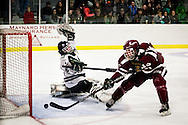Woodstock's goalie Connor Black can't fend off Northfield's Joe Parento as he scores Northfield's fifth goal during Northfield at Woodstock boys hockey in Woodstock, Vt., on February 26, 2014. Northfield won, 5-2. (Valley News - Will Parson)