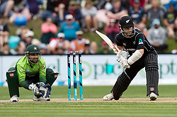 New Zealand's Kane Williamson, right, batting as Pakistan's Sarfraz Ahmed keeps wicket in the third one day cricket international at the University of Otago Oval, Dunedin, New Zealand, Saturday, January 13, 2018. Credit:SNPA / Adam Binns ** NO ARCHIVING**
