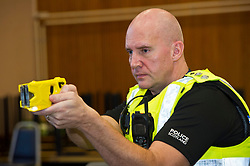 EMBARGOED TILL 16:00 14 DECEMBER 2017<br /> <br /> Pictured: Inspector Jim Young demontstrated the Taser X2<br /> <br /> Deputy Chief Constable Johnny Gwynne was at Tullialan Police College today to make an announcement on police officer safety with 500 sadditional officers being trained and deployed with tasers to combat the number of incidents where officers are injured.<br /> <br /> Ger Harley | EEm 14 Decmber 2017