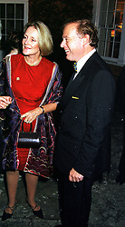 BARONESS BOSCOMBE and her husband MR PHILIP BOSCOMBE, at a party in Oxfordshire on 11th September 1999.MWE 42 2oro