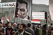 Massive crowd of anti-government protesters occupy Cairo's Tahrir Square, demanding removal of President Hosni Mubarak, depicted on the banner. 09 February 2011.