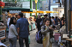 Customers at Borough Market which has opened for the first time since the London Bridge terrorist attack.