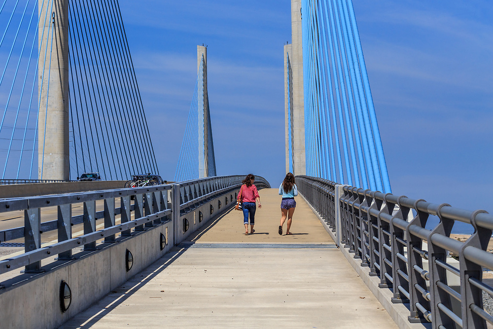 Rehoboth Beach, DE, USA - April 18, 2015: Pedestrians use the walkway on the Delaware Indian River Inlet Bridge.