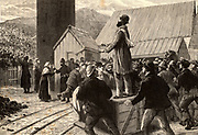 Flooding at Tynewydd Colliery, Rhondda Valley, Wales, 11 April 1877. Scene at the pit head as anxious relatives and colleagues wait for the cage containing trapped miners to reach the surface - dead or alive after to day underground.  Engraving from 'Heroes of Britain' by Edwin Hodder (London, c1880).