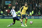 Paul Gallagher (Preston North End) and Arsenal defender Nacho Monreal (18) battle during the The FA Cup 3rd round match between Preston North End and Arsenal at Deepdale, Preston, England on 7 January 2017. Photo by Pete Burns.