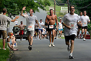 A runner gets a high-five from a specator duirng the 25th annual Orange Classic 10K road race in Middletown, N.Y., on June 11, 2005.