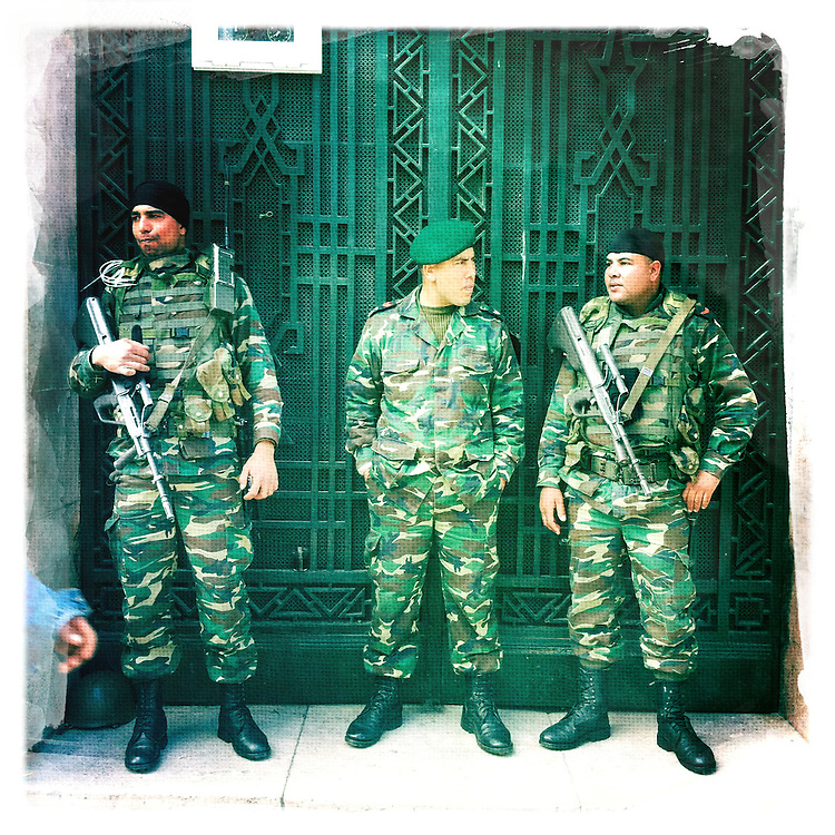 "Military officers are seen at the corner of avenue Habib Bourguiba and street of Rome, Tunis february 6, 2011/// Copyright Benjamin Girette. On january the 14th 2011, Zine el-Abidine Ben Ali President of Tunisia and his famous wife Leila Trabelsi as know as ""The regent of Carthage"" are forced to escape the country after 24 years of power..The revolution is not done yet, Ben Ali is gone nevertheless a democratic President still needs to emerge. A new democraty is in design for the next six months, it might be the birth of the first democraty in the arab world..."