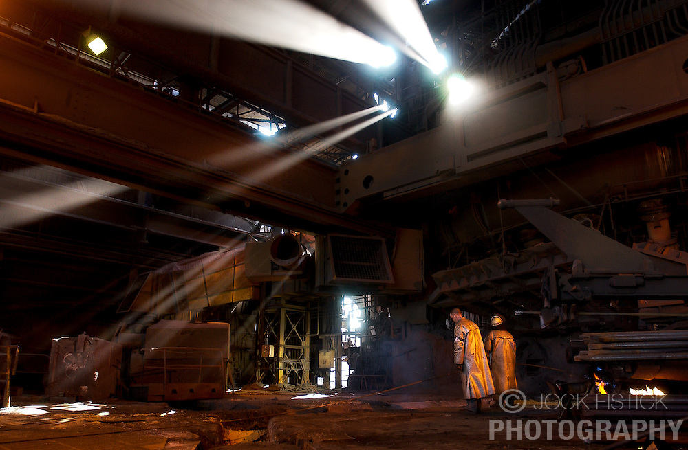 Arcelor employees monitor a blast furnace at the Seraing facility near Liege, Belgium. (Photo © Jock Fistick)