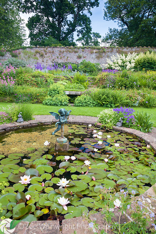 A pretty sunken pond in the gardens of Acorn Bank, Cumbria - photographed in June