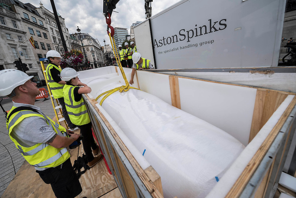 """The installation of Mexican artist Rivelino's 25-ton, 14.5 meter long sculpture You, in King Charles Island in Trafalgar Square. It is the first in a series of high-profile unveilings of contemporary Mexican sculpture across the capital this September, coinciding with the celebratory Dual Year of UK and Mexico 2015 (mexicouk2015.mx). In this case  """"two index fingers, equal in weight, colour and size point towards each other in commanding fashion. Intended as a reflection on human equality, the two pointing fingers are seen from afar as distinct entities; but through engaging in the intervening space between the fingers, the viewer opens up a dialogue of inclusivity. """""""