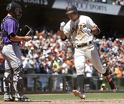 June 28, 2017 - San Francisco, CA, USA - The San Francisco Giants' Jae-Gyun Hwang celebrates as he crosses home plate after his sixth-inning home run against the Colorado Rockies on Wednesday, June 28, 2017, at AT&T Park in San Francisco. The Giants won, 5-3. (Credit Image: © Aric Crabb/TNS via ZUMA Wire)