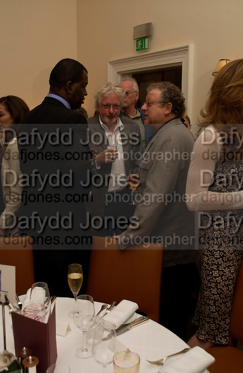 Baz Bambigrove, Hugh Hudson and Jeremy Thomas. Lunch party for Brooke Shields hosted by charles finch and Patrick Cox. Mortons. Berkeley Sq. 6 July 2005. ONE TIME USE ONLY - DO NOT ARCHIVE  © Copyright Photograph by Dafydd Jones 66 Stockwell Park Rd. London SW9 0DA Tel 020 7733 0108 www.dafjones.com