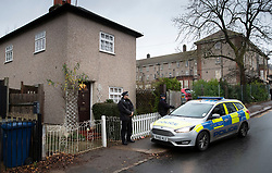 © Licensed to London News Pictures. 05/12/2018. London, UK. Police guard a house in Barnet, north London where a 77 year old woman has died after a burglary. The victim called Police to her address on Bells Hill around 6.00pm yesterday, after two suspects forced entry and stole her property. During the phone call to the 999 operator the woman collapsed.  She died in hospital this morning. Photo credit: Peter Macdiarmid/LNP