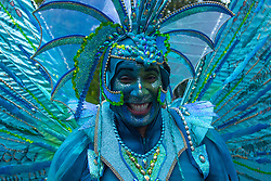 London, August 29th 2016. Blue and green feature in this man's costume as the procession moves along Ladbroke Grove during day two of Europe's biggest street party, the Notting Hill Carnival.