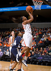 Virginia forward Monica Wright (22) shoots a close range jump shot against MU.  The Virginia Cavaliers women's basketball team defeated the Monmouth Hawks 71-45 at the John Paul Jones Arena in Charlottesville, VA on December 18, 2008.