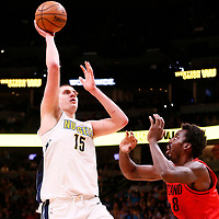 09 April 2018: Denver Nuggets center Nikola Jokic (15) takes jump shot over Portland Trail Blazers forward Al-Farouq Aminu (8) during the Denver Nuggets 88-82 victory over the Portland Trail Blazers, at the Pepsi Center, Denver, Colorado, USA.