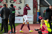 Sean Clare (#8) of Heart of Midlothian FC pulls his jersey over his face as he makes his way up the tunnel, after receiving a red card during the Ladbrokes Scottish Premiership match between Heart of Midlothian FC and Aberdeen FC at Tynecastle Stadium, Edinburgh, Scotland on 29 December 2019.