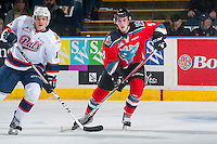 KELOWNA, CANADA - NOVEMBER 26: Braydon Buziak #15 of the Regina Pats checks Konrad Belcourt #5 of the Kelowna Rockets on November 26, 2016 at Prospera Place in Kelowna, British Columbia, Canada.  (Photo by Marissa Baecker/Shoot the Breeze)  *** Local Caption ***