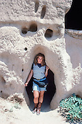 Portrait of me by Tirzah Sheehy at Puye Cliff Dwellings, 1989.