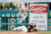 PITTSBURGH, PA - AUGUST 16: Mark Ellis #14 of the Los Angeles Dodgers jumps over Garrett Jones #46 of the Pittsburgh Pirates during a game at PNC Park on August 16, 2012 in Pittsburgh, Pennsylvania. The Pirates won 10-6. (Photo by Joe Robbins)