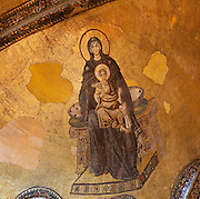 Detail of Deesis mosaic of the Virgin Mary and Jesus (Theotokos and Christ), 12th-13th century, Hagia Sophia, 532-37, by Isidore of Miletus and Anthemius of Tralles, Istanbul, Turkey. Hagia Sophia, The Church of the Holy Wisdom, has been a  Byzantine church and an Ottoman mosque and is now a museum. The current building, the third on the site, commissioned by Emperor Justinian I, is a very fine example of Byzantine architecture. The historical areas of the city were declared a UNESCO World Heritage Site in 1985. Picture by Manuel Cohen.