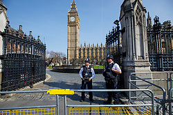 © Licensed to London News Pictures. 27/03/2017. London, UK. A police officer reopen the carriage ways to the Houses of Parliament after Westminster terror attack in London on Monday, 27 March 2017. Photo credit: Tolga Akmen/LNP