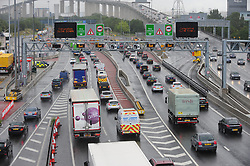 © Licensed to London News Pictures. 22/07/2017<br /> Heavy traffic Anti-CLOCKWISE into the Dartford tunnels at the Dartford Crossing in Kent.<br /> Drivers face wet weather conditions as the great summer holiday weekend getaway continues today with millions of drivers taking to the UK's roads. <br /> Photo credit: Grant Falvey/LNP