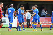 AFC Wimbledon striker Lyle Taylor (33) scores a goal 1-0 and celebrates during the EFL Sky Bet League 1 match between AFC Wimbledon and Shrewsbury Town at the Cherry Red Records Stadium, Kingston, England on 24 September 2016. Photo by Stuart Butcher.