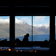A view of Queenstown from Skyline Queenstown restaurant and cafe. Skyline is accessible by scenic gondola and has panoramic views of Queenstown...Queenstown is nestled on the shores of the crystal clear waters of Lake Wakatipu in the Central Otago region of the South Island of New Zealand..Queenstown is New Zealand's premier tourist destination providing an abundance of year round outdoor activities for both young and old. Queenstown, Central Otago, South Island, New Zealand. 18th May 2011. Photo Tim Clayton.