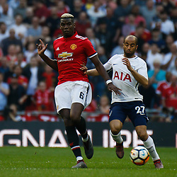 Paul Pogba of Manchester United and Lucas of Tottenham Hotspur during the Emirates FA Cup match between Manchester United and Tottenham Hotspur at Old Trafford on April 21, 2018 in Manchester, England. (Photo by Rob Sambles)