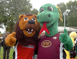 KETTERING TOWN CHAMP THE LION, POSES WITH NORTHAMPTON TOWNS CLARENCE THE DRAGON, John Smiths Mascot Grand National, Huntingdon Racecourse Sunday 5th October 2008