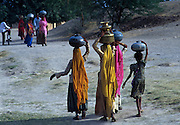 Tribal women collecting water from the Oasis of Lourdhia