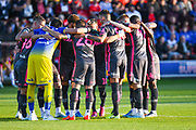 Leeds United players huddle during the EFL Cup match between Salford City and Leeds United at Moor Lane, Salford, United Kingdom on 13 August 2019.