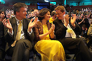 © Licensed to London News Pictures. 21/09/2011. BIRMINGHAM, UK. The wife of The Deputy Prime Minister Miriam González Durántez sits between (L-R) Michael Moore and Danny Alexander. Deputy Prime Minister Nick Clegg delivers his keynote speech at the Liberal Democrat Conference at the Birmingham ICC today (21 Sept 2011): Stephen Simpson/LNP