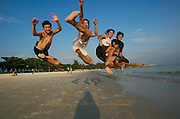 Hat Sai Kaew. Kittipong Noek de Haan (2nd from l.) and his friends have fun on the beach.